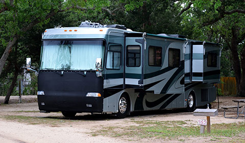 recreational vehicle ( R V ) parked at camp site