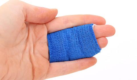 a worker's fingers bandaged together
